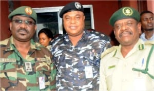 L-R: Commander, 2 Brigade, Nigerian Army, Brig.-Gen Osasogie Uzamere, Commissioner of Police, Rivers, Mr Tunde Ogunsakin  and Controller of Prison, Rivers,Mr Patrick Ondoma, during Inter-Agency Consultative Committee meeting on Election Security in Port Harcourt, yesterday .