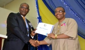 General Manager Rivers State Newspaper Corporation, Mr. Celestine Ogolo (right) receiving an award from the past President of Rotary Club of Port Harcourt, Rtn, Chidi Ikeji, during the induction ceremony of Rtn Frank Eni at Rotary centre Trans-Amadi, Port Harcourt, recently. Pix: Nwiueh Donatus Ken.