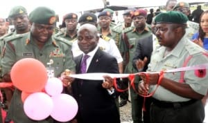L-R: Chief of Army Staff, Lt.-Gen. Kenneth Minimah, Group Managing Director, Diamond Bank, Dr Alex Otti and Commanding Officer, 65 Battalion, Lt.-Col. Haruna Dasuki, commissioning an ultra modern block for the battalion in Lagos last Tuesday. Photo: NAN