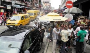 Commercial activities peaking at Balogun Market in Lagos State after Eid-el-Fitr holidays recently.