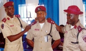 FRSC Deputy Route Commander, Mr Stanley Onyebuchi, being decorated by Anambra Sector Commander, Mr Hyginus Omeje (left) and Sector Head of Operations, Mr Jones Malomo, in Awka last Thursday.