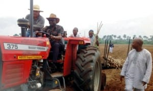 Delta State Commissioner for Agriculture and Natural Resources, Mr Misan Ukubeyinje, operating a tractor at the Federal Government Cassava Farm Project,  to mark the Commencement of cassava planting on the farm in Abraka, recently.