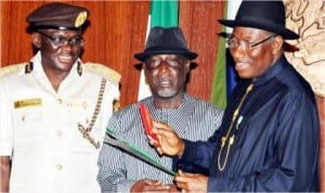 L-R: Comptroller-General of Immigration, David Parradang, Minister of Interior, Comrade Abba Moro and President Goodluck Jonathan, during the launch of  new e-Passport at the Federal Executive Council meeting in Abuja, recently.