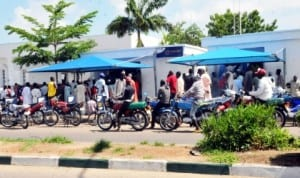 People queuing to cash money from Atm in Bauchi, recently.