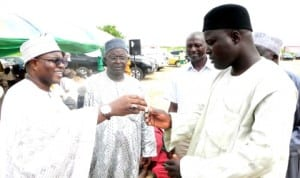 Chairman, Board of Directors, Ashaka Cement Plc, Alhaji Umaru Kwairanga (left), Presenting a key to Danladi Jibir, a Beneficiary to  1 of  the 55 houses built by Ashaka Cement Plc at Ladde-Bage village of Funakaye Lga of Gombe, recently.