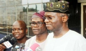 Governor  Babatunde Fashola of Lagos State  (right), speaking to newsmen on Ebola Virus on his arrival from Lesser Hajj in Lagos recently.  With him are his Special Adviser on Media, Mr Hakeem Bello (left) and  Commissioner for Information and Strategy, Mr Lateef Ibirogba.