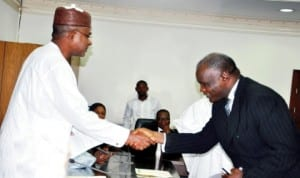 L-R: Governor Isa Yuguda of Bauchi State (left), congratulating the New Acting Chief Judge of the State, Justice Aliyu Liman, at the swearing-in in Bauchi recently. Photo: NAN