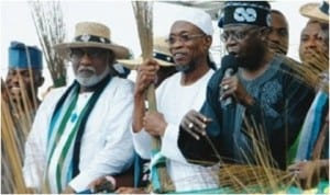 National Leader of All Progressives Congress (APC), Senator Bola Ahmed Tinubu ( right), Governor of Osun State,Ogbni Rauf Aregbesola (2nd right) and another party elder at the APC mega rally yesterday in Oshogbo ahead of the governors election in the state on Saturday