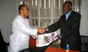 General Manager, Rivers State Newspaper Corporation (RSNC), Mr Celestine Ogolo (left), presenting some copies of Tide Newspaper to the Chairman, 80 County Run, Comrade, M.O. Raleigh - Joe,  during the offical visit of the group to the corporation last Tuesday. Photo: Nwiueh Donatus Ken