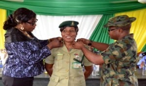 Commander, Nigeria Drugs Law Enforcement Agency, Rivers State Command,  Shellang Rachael (left) , with  Lt. Col Kingsely Adimoha of the Nigerian  Army (right),  decorating Public Relations Officer  of Nigeria Prisons Service, Rivers State Command, Mrs Juliet Ofoni,   at the decoration of  newly promoted officers of the command  in Port Harcourt recently. Photo: Ibioye Diama