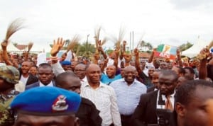 Rivers State Governor, Rt Hon Chibuike Rotimi Amaechi being cheered by a crowd of supporters during his 'meet the people' tour of Isiokpo Community in Ikwerre Local Government Area of the state, recently.