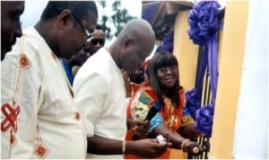 Rivers State Commissioner for Information and Communications, Mrs Ibim Semenitari, commissioning the water project built by her  in Okrika last Friday. With her are Rivers Deputy Chairman, All Progressives Congress, Prince Peter Odike (left) and other personalities. Photo: Chris Monyanaga