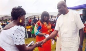 Chief of Staff, Government House, Port Harcourt, Sir Tony Okocha (right) presenting empowerment package from APC Ward 5 Okirika to beneficial market women during the Chief of Staff's commissioning of water project at the Ward last Friday. Photo: Chris Monyanaga
