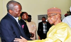 Governor Babatunde Fashola of Lagos State (left), with former Chief Justice of Nigeria, Justice Dahiru Musdapha, at the inter-faith Conference  in Abuja, yesterday.