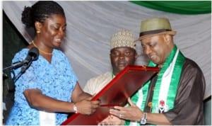 A youth leader, Mosunmola Umoru (left), presenting an award to Vice President, Namadi Sambo, at the 2014 International Youth Day celebration in Abuja, yesterday