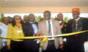 Manager, Occupational Health Mobil Producing Nigeria; Dr. Ayodele Fagbemi (3rd right) cutting a tape for official commissining of completed project at FAAN Medical Centre at Port Harcourt Int'l Airport, Omagwa recently. With him are Regional General Manager, FAAN, Mrs. Ebele Okoye (left), General Manager Medical, FAAN, Lagos, Dr. Oduwole Wale (2nd left), Paramount Ruler of Igwuruta, HRH. Eze (Prof.) Samuel N. Wekhe. Photo: Egberi A. Sampson