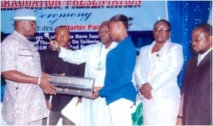 Rivers State Commissioner for Youth Development, Sir Owene Wonodi, presenting a starter pack to skills acquisition graduand.