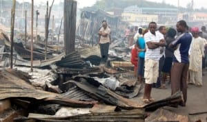 Traders and sympathizers at Aleshinloye market razed by midnight fire in Ibadan recently.