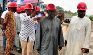 Chairman, Subsidy Re-Investment and Empowerment Programme (SURE-P), Retired Gen. Martin Lurther-Agwai (2nd right), inspecting the Light Rail Project in Abuja last Friday. With him is the Coordinator, SURE-P Operations, Mr Ali Fatoma.