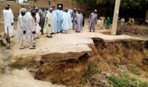 Jigawa State  government officials inspecting a landslide caused by flood in Taura Local Government Area, recently. Photo: NAN