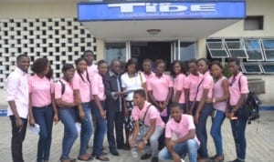 Rivers State Newspaper Corporation Political Editor , Mr. Boye Salau (middle) with copy of The Tide newspaper in a group photograph with victory tenage group of Shekinah Church Mission, during the group's visit to the corporation, recently. Pix: Nwiueh Donatus Ken