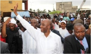 Rivers State Governor Chibuike Amaechi salutes the crowd in Rumukurushi community, during his 'meet the people tour of Communities in Obio/Akpor Local Government Area of the state, last Tuesday