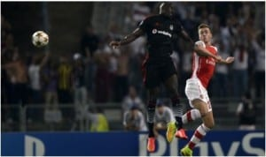 An aerial contest between Demba Ba of Besiktas and Arsenal's Chambers in last night UEFA Champions League first leg play-off in Turkey