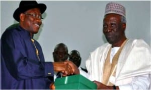 President Goodluck Jonathan (left) receiving the National Conference report from the chairman of the confab, Justice Idris Kutigi at the Presidential Villa, Abuja, yesterday