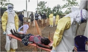 Medical personnel carrying an Ebola virus victim in Lagos, recently