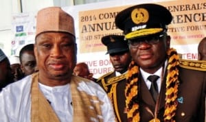 Former Minister of Internal Affairs, Senator Mohammed Magoro (left) with Comptroller General of Immigration, Mr David Parradang, at the 2014 Comptroller-General's Annual Conference in Abuja last Friday. Photo: NAN