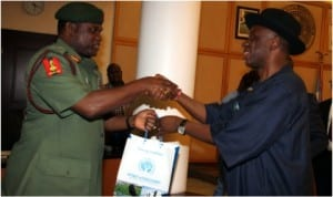 Rivers State Governor, Rt Hon Chibuike Amaechi (right) presenting a souvenir to the Chief of Army Staff, Lt-Gen Kennth Minimah, during his courtesy visit to Government House, Port Harcourt at the weekend.