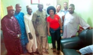 Chairman of National Butchers' Association of Nigeria, Rivers State Chapter, Alhaji Musa Baba Ahmed (middle) in a group photograph with members of the executive.