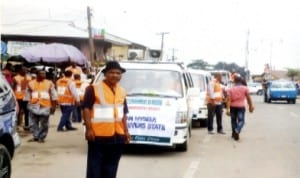 Head of Public Affairs Department, Rivers State Waste Management Agency, Mr Tam Konacree (front) leading the awareness campaign to Road/Streets in Port Harcourt, recently. Photo: Chris Monyanaga