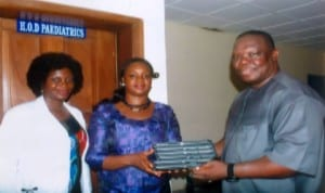 Specail Adviser to Rivers State Governor on ICT, Engr Goodliffe Nmekini (right), presenting Ipads to Head of Paediatrics Department, Braitwaite Memorial Hospital, Dr Ajibola Alabi (middle).  With them is, Dr Josephine Aiyafo, durig inspection of ICT facilities at the hospital in Port Harcourt recently. Photo: Egberi A. Sampson