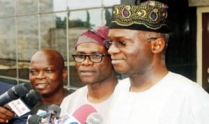Gov. Babatunde Fashola of Lagos State (right) speaking to newsmen on Ebola virus on his arrival from Lesser Hajj in Lagos recently. With him are, his Special Adviser on Media, Mr Hakeem Bello (left) and  Commissioner for Information and Strategy, Mr Lateef Ibirogba. Photo: NAN