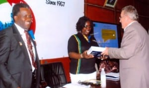 Airfrance, District Manager, South-East Nigeria, Peyo Labeguerie (right), presenting a souvenir to Executive Chairman,  Rivers State Internal Revenue Service, Onene Osila Obele-Oshoko (middle), at the PHCCIMA council meeting,  recently. With  them is President, PHCCIMA, Engr Emeka Unachukwu. Photo: Egberi. A. Sampson