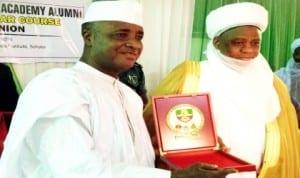 Governor  Aliyu Wamakko of Sokoto State (left), receiving a souvenir from Sultan of Sokoto, Alhaji Sa'ad Abubakar 111 for attending the Nigerian Defence Academy Alumni 18th Regular Course Re-Union in Sokoto, recently.