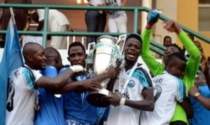 Enyimba players celebrating with the Federation Cup trophy last year. They will face Dolphins in the final match of the 2015 edition on September 28