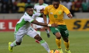 Super Eagles' midfielder, Ogenyi Onazi (left) struggling to stop Bafana Bafana player during their Africa Cup of Nations qualifier in South Africa on Wednesday