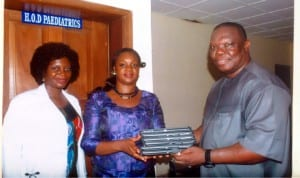 Special Adviser to the Rivers State Governor on ICT, Engr. Goodliffe Nmekini (right), presenting Ipads to HoD, Paediatrics, BMSH, Dr Ajibola Alabi (middle), during inspection of ICT facilities at the hospital recently. With them is Dr Josephine Aiyafo.