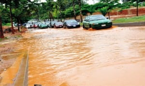 Flooded road at Area 8, Garki, after a downpour in Abuja recently. Photo: NAN