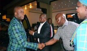 Rivers State Governor, Rt Hon Chibuike Amaechi (left) being welcomed  to the 2014 Native and Vogue Port Harcourt International Fashion Week by member of House of Representatives, Honourable  Asita, while the Commissioner for Information and Communications, Mrs Ibim Semenitari watches, last Friday in Port Harcourt.  Photo: Ibioye Diama
