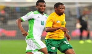 Super Eagles midfielder, Mikel Obi (10) against a South African player in the goalless draw in Cape Town