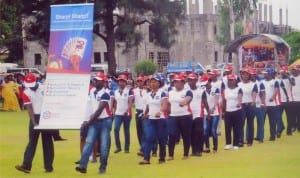 Staff of Credit Direct, participating in a march past, during a public event in Port Harcourt recently.