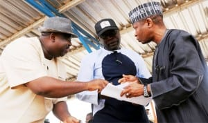 L-R: Chairman, Mangu Local Government Area of Plateau State, Mr Caleb Mutfwang, Plateau Commissioner for Water Resources, Mr Idi Waziri and representative of Minister of Water Resources, Mr Moyi Kabir, going through a document during inspection of Gindiri Dam  recently.