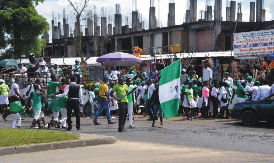 Soul's Generators Outreach members  celebrate Nigeria's 54th  Independence Day in Port Harcourt, yesterday. Photo: Egberi A. Sampson