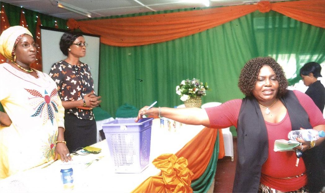Representative of the Geneal Manager, Rivers State Newspaper Corporation and Director of Publication, Mrs Juliet Njiwhor (right) casting her vote at the (NAWOJ) election at the Ministry of Women Affairs, last Friday at the 5th Triennial Delegate Conference, Rivers State