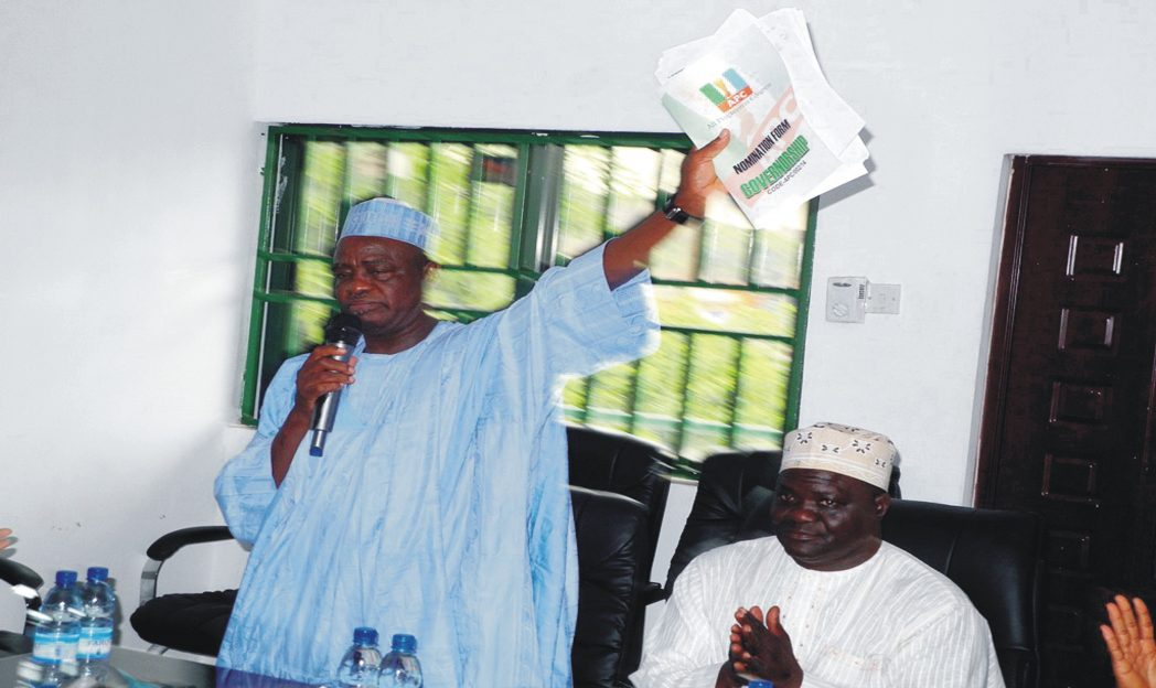 Governorship aspirant of the All Progressives Congress (APC) for the October 11 governorship by-election in Adamawa State, Mr. Yakubu Tsalla (left), displaying his intent and nomination forms during his declaration at the APC Secretariat in Yola, recently. Photo: NAN