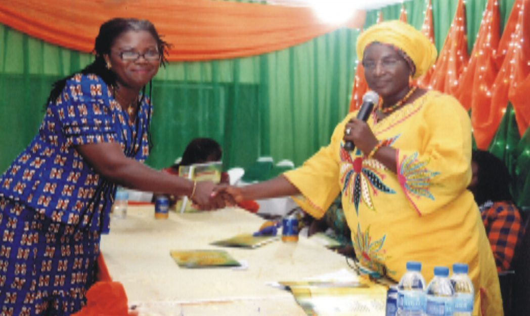 Vice President, Zone F, Nigeria Association of Women Journalists(NAWOJ), Comrade Timi Idoka(right), congratulating Rivers State Chairman, NAWOJ, Mrs Lilian Okonkwo. Photo: Chris Monyanaga