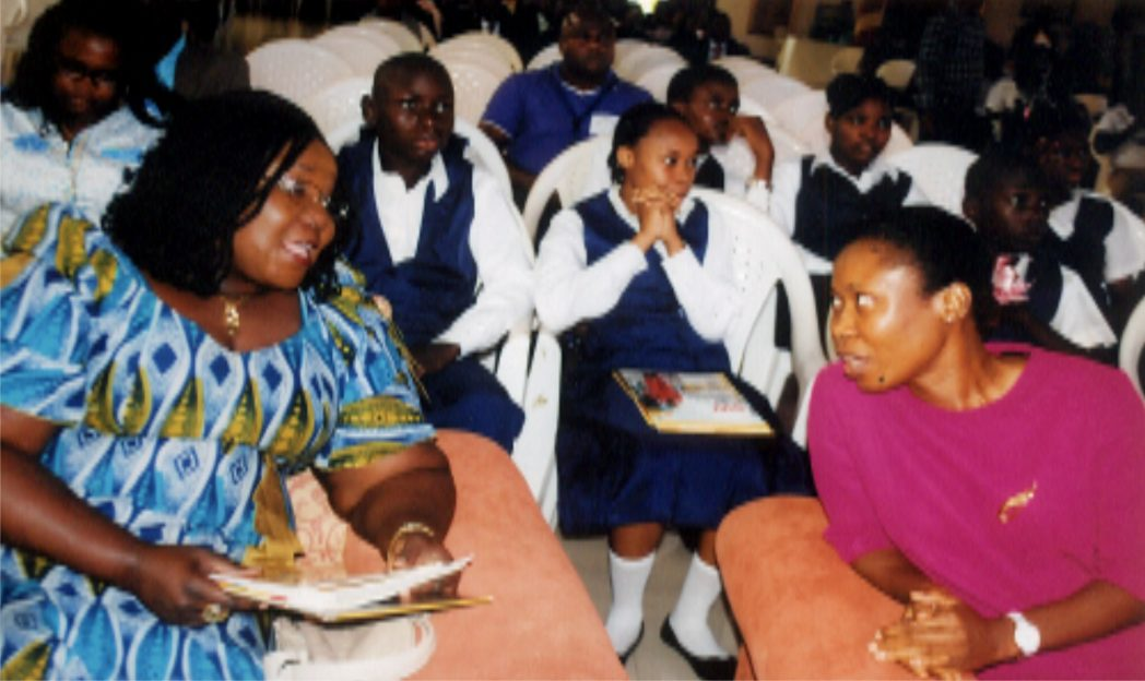 Rivers State Commissioner for Information and Communications, Mrs Ibim Semenitari (left), chatting with Dr Comfort-Ogbu of Jephtha Comprehensive Secondary School, Port Harcourt at the Cradle to Career Scholarship Scheme organised by SPDC  at Brookstone Secondary School, Igwuruta, Port Harcourt recently. Photo: Obinna Prince Dele